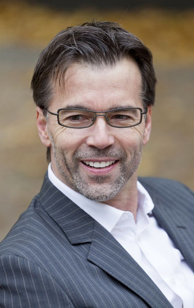 Portrait of a businessman with glasses smiling outside
