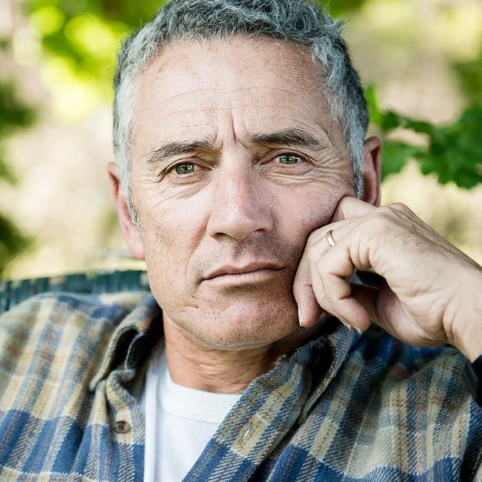 A man staring straight ahead after being treated for retinal hemorrhage