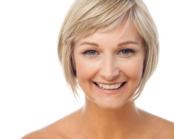 Smiling blonde woman on white background