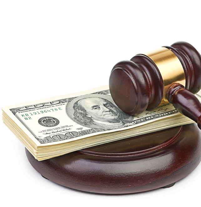 A stack of money on a judge's gavel