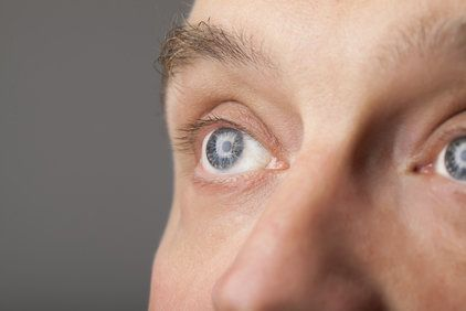 Close up of man's blue eyes