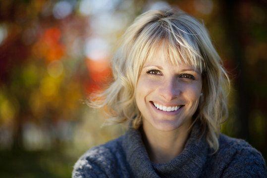 Smiling woman wearing gray sweater