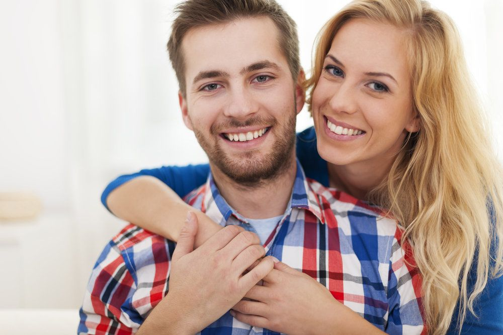 Young couple with white, healthy teeth