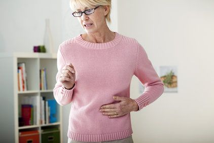 Woman feeling her stomach