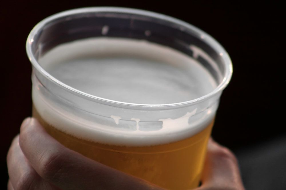Close-up of a beer in a man's hand