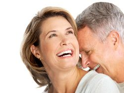 A middle-aged couple laughing together
