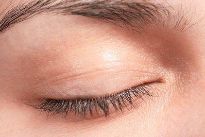 Closeup of a closed woman's eye