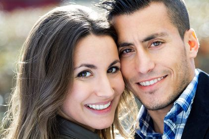 Couple with faces touching and smiling
