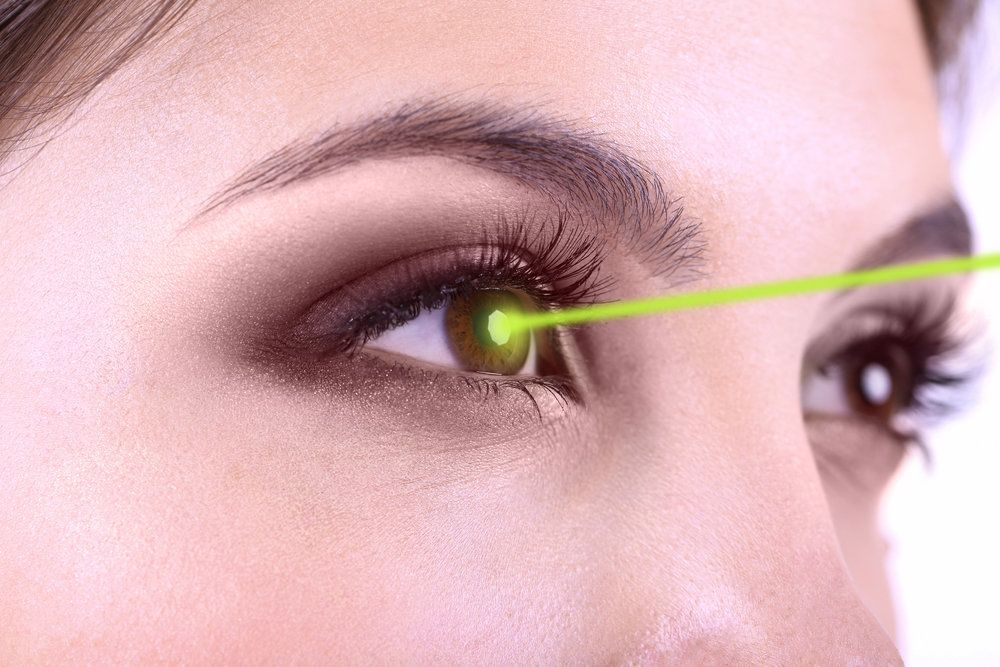 A woman having a laser shined into her eye