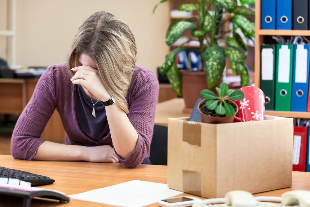 A female employee crying in response to workplace retaliation.