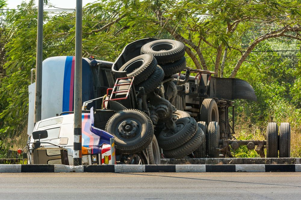 An overturned large truck after a rollover accident