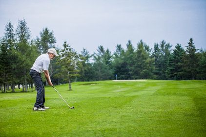 An older man golfing
