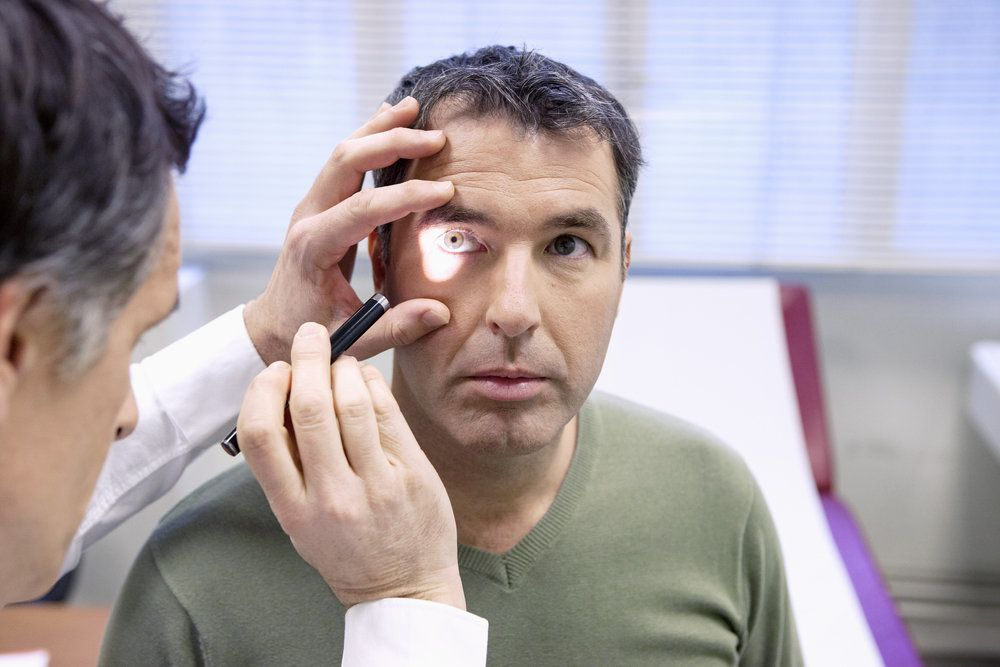 A patient undergoing an eye exam after being diagnosed with keratoconus