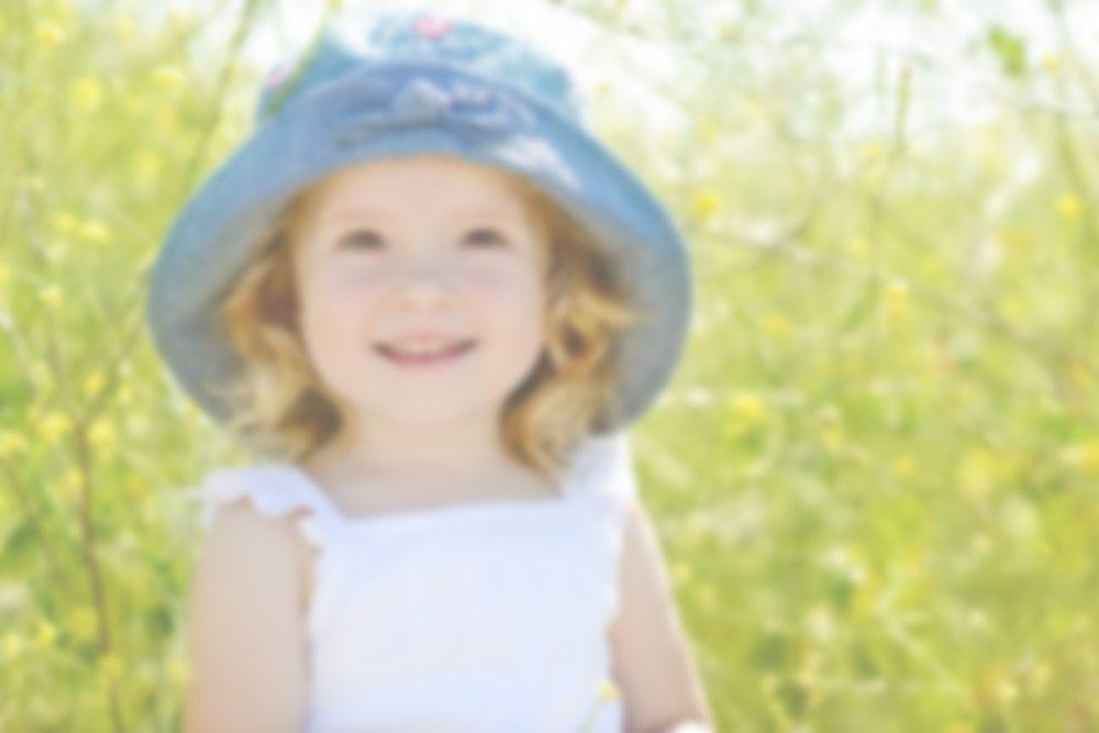 Toddler girl wearing blue hat