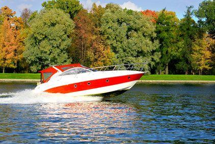 Speed boat races along waterway
