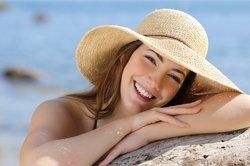 Smiling woman in a sun hat