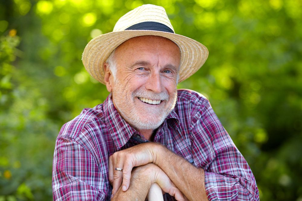 An older man with a complete and healthy smile