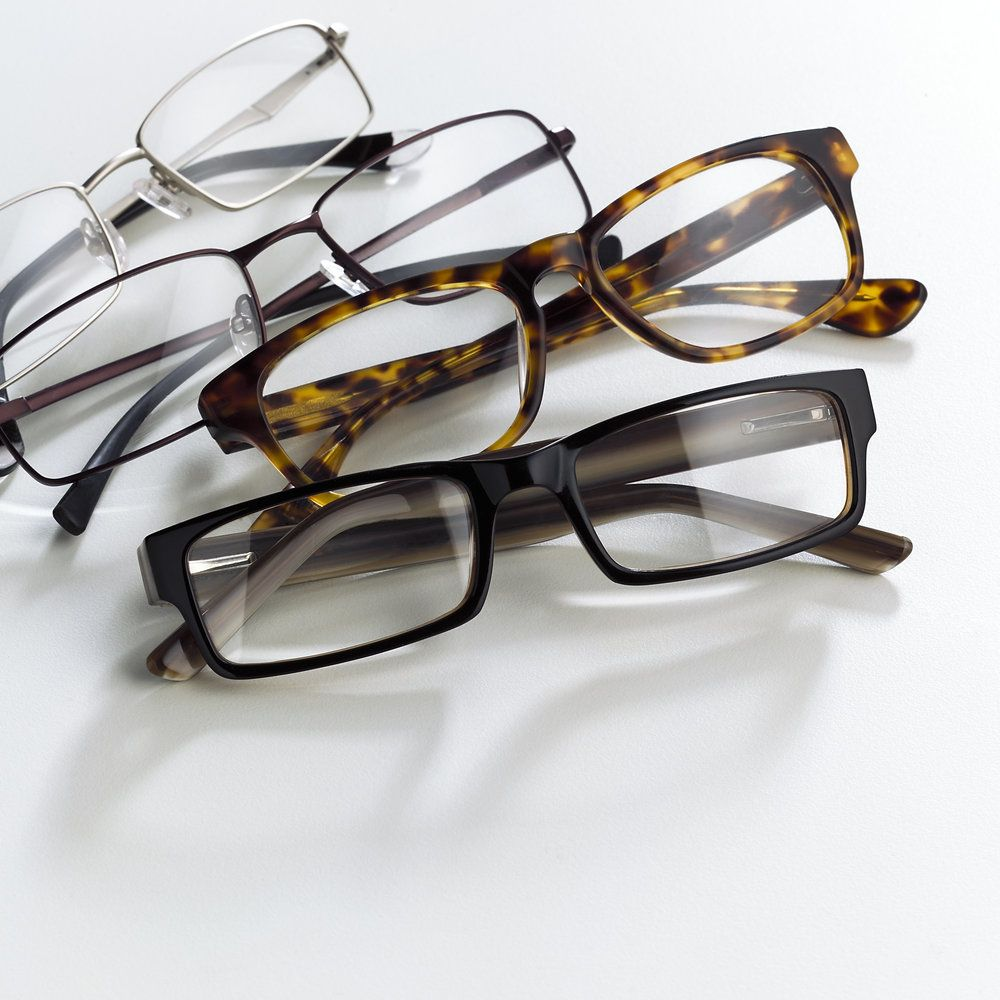 Four reading glasses on a white background