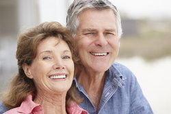 Elderly man and woman with healthy, attractive teeth