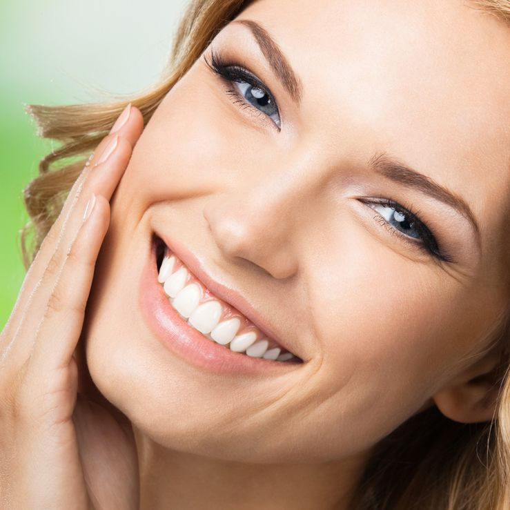 A woman with a radiant, youthful smile after cosmetic dental bonding
