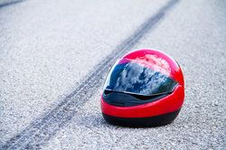 A motorcycle helmet on the road
