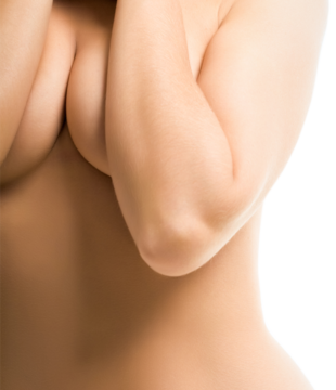Topless woman pushing breasts together with her elbows