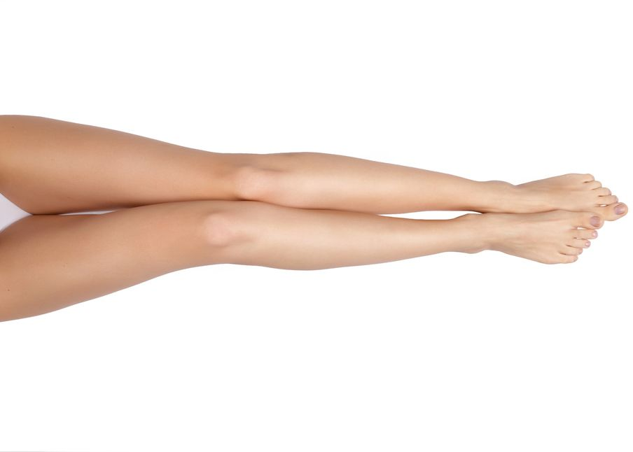 A woman's svelte legs after liposuction recovery
