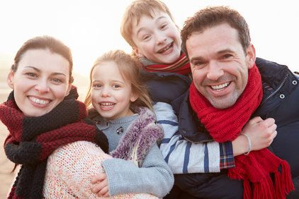 Smiling family outdoors in the winter