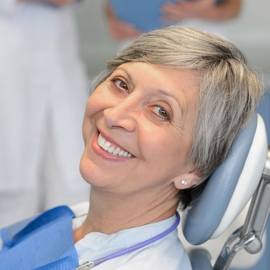 Female patient in the dental chair for treatment