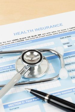 A health insurance form and stethoscope