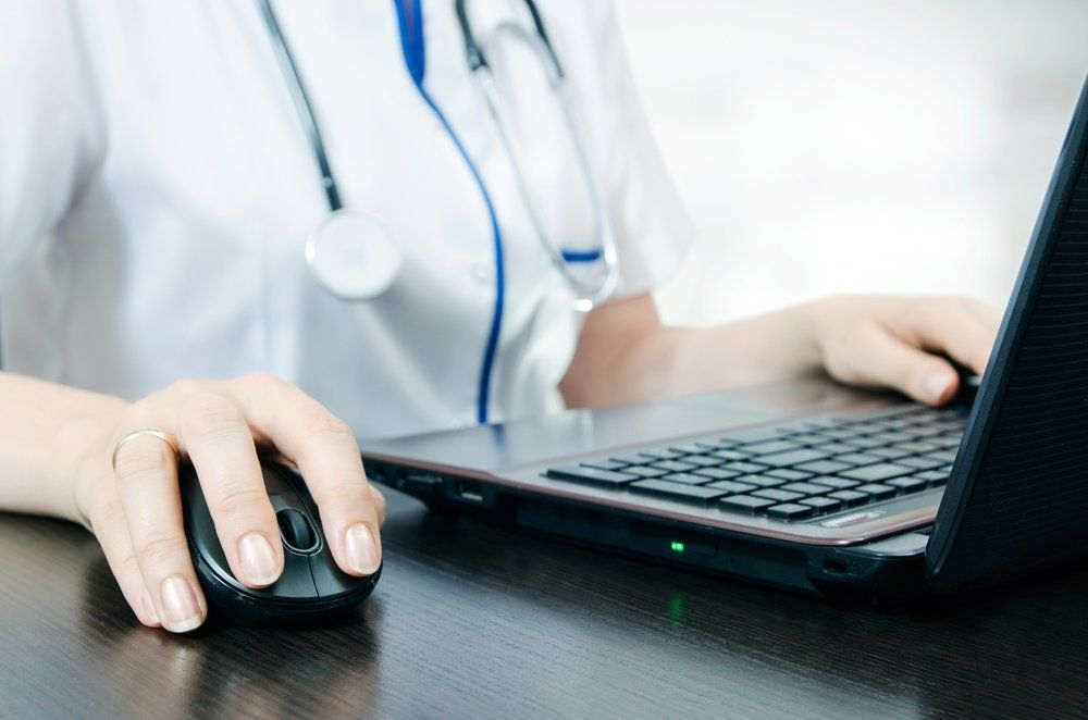 Healthcare provider working on a laptop