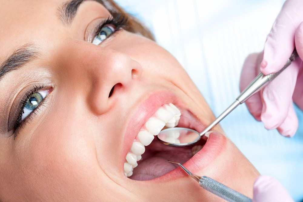 A woman undergoing a dental exam