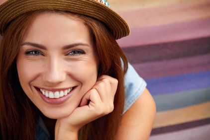 Brunette woman with a beautiful smile.