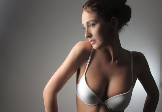 Thin, shapely woman posing in white bra