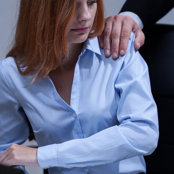 Man touching a woman on the shoulder