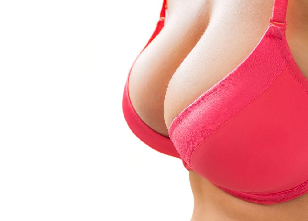 A woman in a pink bra