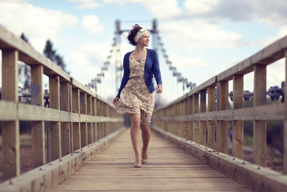 Woman walking on bridge