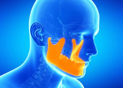 Illustration of man's jaws contrasted against the rest of his head