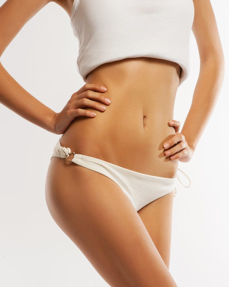 Close-up on woman's slim stomach