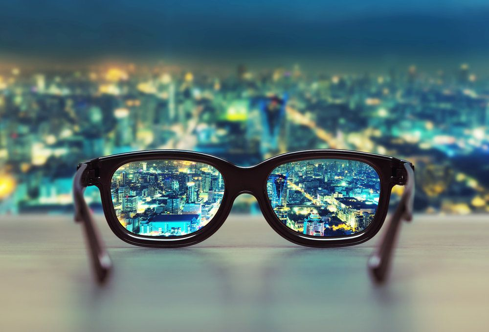 Clear view of the city through the lenses of a pair of glasses
