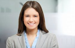 A smiling female in a business suit