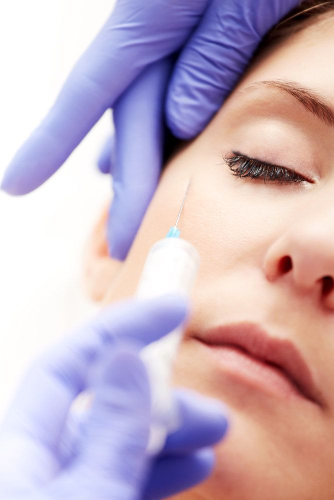Woman receiving BOTOX® injections