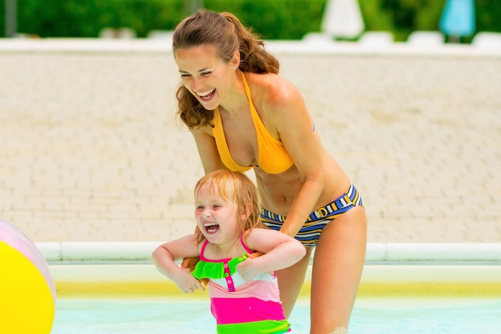 A mom wearing a bikini after mommy makeover recovery