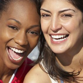Two young women smiling and laughing