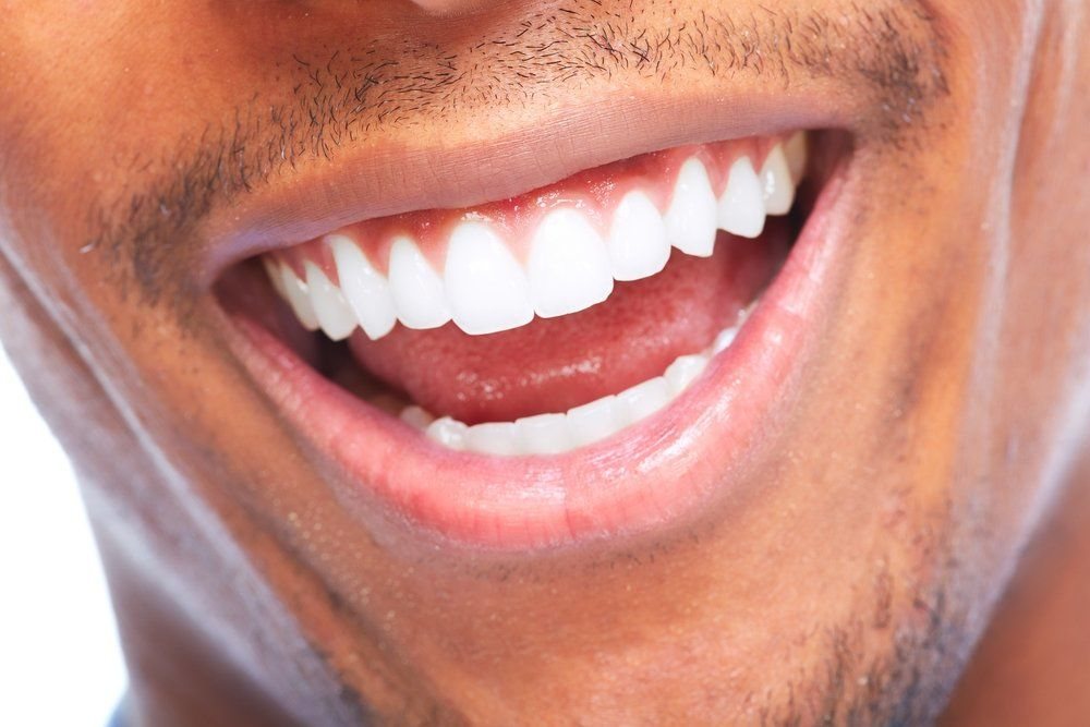 Close up of man's very white teeth