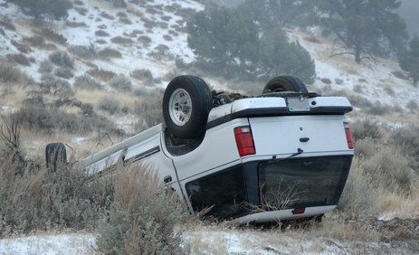 SUV involved in crash laying upside down