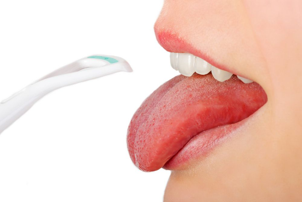 Using a tongue scraper