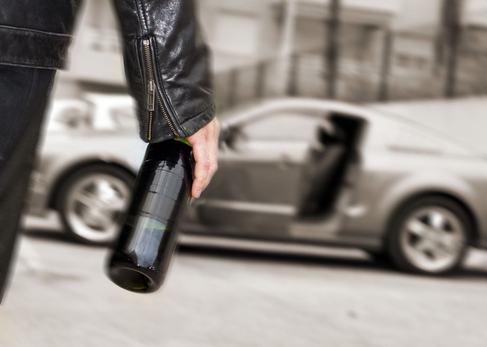 A bottle of wine and a car