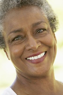 An older woman with a healthy, beautiful smile
