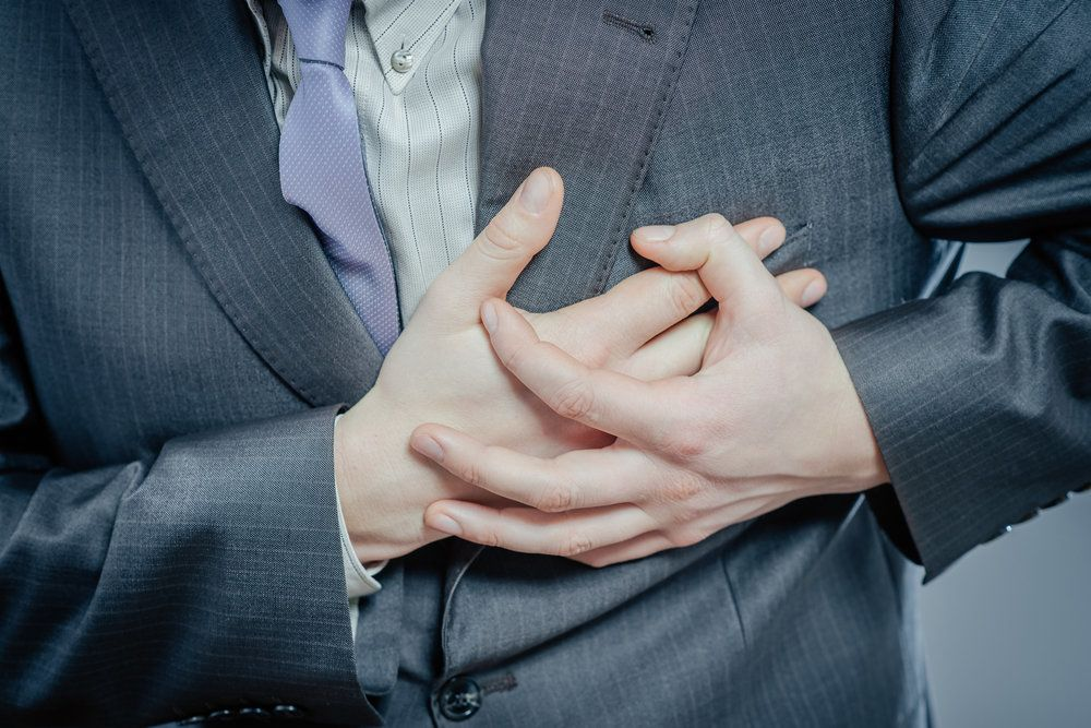 businessman clutching heart